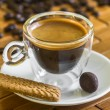 Cup of italian espresso with biscuit and almond in chocolate — Stock Photo