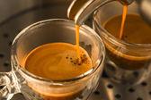Mainstream of strong espresso coffee — Stock Photo