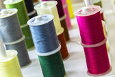 Spools of sewing thread of different colors — Stock Photo
