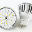 Stock Photo: Two MR16 LED bulbs without accidentally
