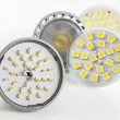 Stock Photo: Four various versions of LED bulbs for GU10 and MR16