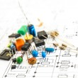 Stock Photo: Electronic components on schematic diagram background.