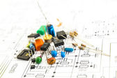 Electronic components on a schematic diagram background. — Stock Photo