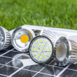 Stock Photo: Various GU10 LED bulbs on photovoltaics in grass