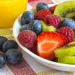 Постер, плакат: Ripe berry and kiwi with orange juice
