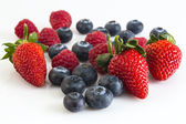 Ripe berries of raspberries, strawberries and blueberries — Stock Photo