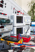 Faulty solar regulator and checking using an oscilloscopes — Stock Photo