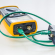 Network tester with green RJ45 cable 5e connected for testing — Stock Photo #50526875