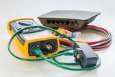 Network tester and small switch with various color RJ45 cables c — Stock Photo
