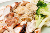 Chicken and risotto — Stock Photo