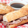French beef dip sandwich au jus - Stock Photo