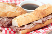 French beef dip sandwich au jus — Stock Photo