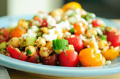 Gluten free vegetarian salad made with quinoa, chickpeas, feta a — Stock Photo