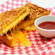 Decadent grilled cheese sandwiches with oozing cheese running ou — Stock Photo
