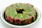 Raw lamb chops marinading in mint and oil — Stock Photo