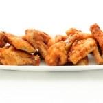 Dry rub deep fried chicken wings, heartburn on a plate — Stock Photo #32261613