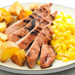Brined pork tenderloin with grilled corn and roasted potatoes — Stockfoto