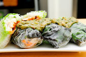 Rice paper wrapped chicken with vermicelli noodles and a thai pe — Stock Photo