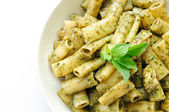 Rigatoni pesto pasta with chicken, basil and parmesan cheese and — Stock Photo
