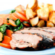 Grilled pork tenderloin brined and served with potato wedges and — Stock Photo