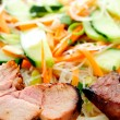 Brined pork tenderloin with rice noodles in cool summer salad — Stock Photo