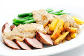 Grilled pork tenderloin with french fries, bans and a rich mushr — Stok fotoğraf