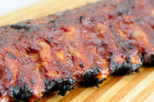 Pork bbq ribs, meaty ribs smothered with bbq sauce — Stock Photo