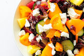 Beet salad with heirloom tomato, cucumber and goat cheese — Stock Photo