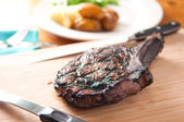 Rare rib steak fresh from the grill — Stock Photo