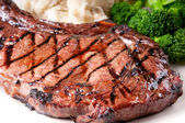 Juicy bbq rib steak with garlic mashed potatoes and brocolli — Stock Photo