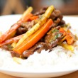 Orange beef stir fry over white rice. made with flank steak — Stock Photo #51491193