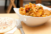 Chicken korma, a spicy Indian themed meal of diced chicken, rice and creamy korma sauce — Stock Photo