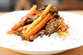 Orange beef stir fry over white rice. made with flank steak — Stock Photo
