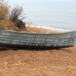 Old boat on the beach — Stok fotoğraf