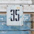 Royalty-Free Stock Photo: Plate with a number on the wall