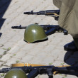Stock Photo: Helmets and assault rifles lay on ground