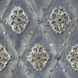 Seamless texture nailed metal floral decoration - Stock Photo