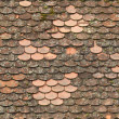 Seamless red old roof tiles repaired texture — Stock Photo #18230637