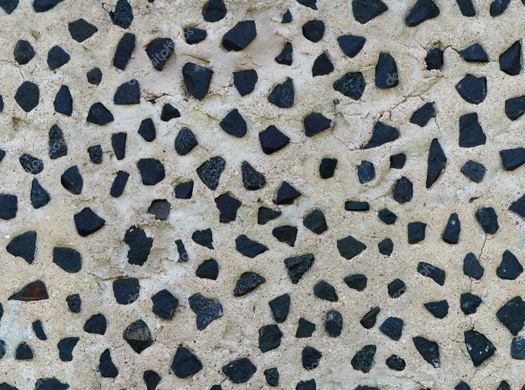 Plaster Wall Texture Seamless Seamless Old Plaster Wall Texture With Pieces of Black Granite Photo by