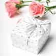 Gift and flowers — Stockfoto #39015069