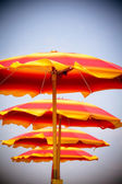 Sunshades at the beach on a very sunny day — Stock Photo