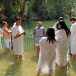 Stock Photo: Israel Pilgrims prepare for ablution in holy waters of JordRiver