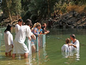 Israel Ablution in holy waters of the Jordan River — Stock Photo