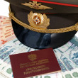 Military peak-cap and pension certificate — Stock Photo