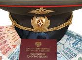 Military peak-cap and pension certificate — Stock Photo