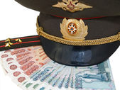 Military peak-cap, shoulder strap and Russian money — Stock Photo