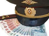 Military peak-cap, shoulder strap and Russian money — Stock Photo