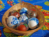 Colored Easter eggs in a wattled support — Stock Photo