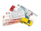 Driver's license, Russian money and models of cars — Stock Photo