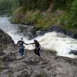 Stock Photo: Tourists at Kivach Falls, Karelia